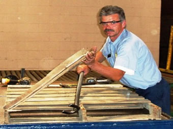 Pallet recycling begins with repairing damaged pallets